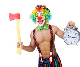 Funny clown holding an axe and alarm clock Stock Photo