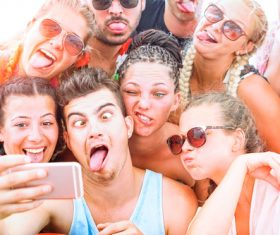 Funny expressions of young friends taking selfies Stock Photo