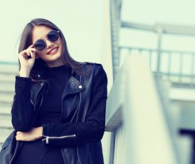 Girl in black outfit outdoors Stock Photo 04