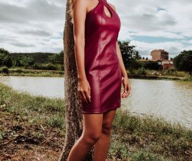 Girl in red leather skirt by the river Stock Photo