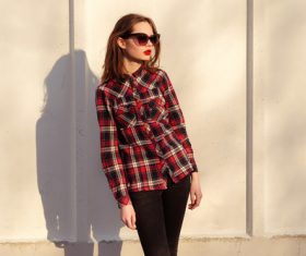 Girl in red plaid shirt wearing sunglasses Stock Photo