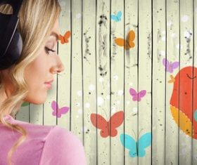 Girl listening to music standing in front of cartoon painted wall background Stock Photo 01