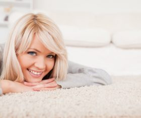 Girl lying on the carpet Stock Photo 03