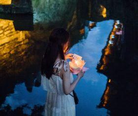 Girl putting river lights Stock Photo