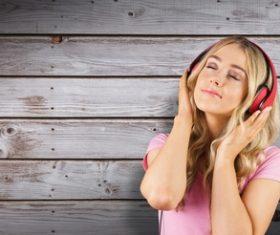Girl reveling in music Stock Photo