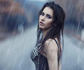 Girl standing in the rain Stock Photo