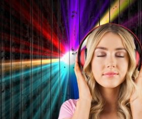 Girl with closed eyes listening to music Stock Photo