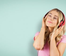 Girl with headphones closed eyes listening to music Stock Photo