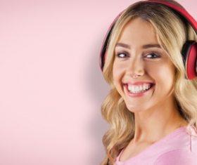 Girl with headphones smiling Stock Photo