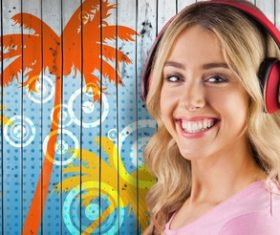 Girl with headphones smiling standing in front of coconut tree wall background Stock Photo