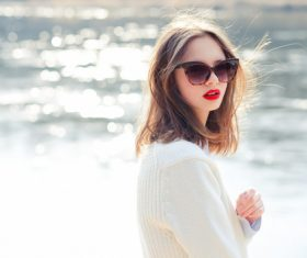 Girl with sunglasses and red lipstick on the lakeside Stock Photo