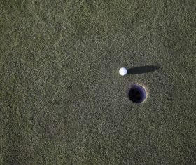 Golf ball and hole Stock Photo 01