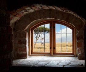 Grassland scene outside of brick houses window Stock Photo