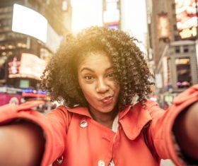 Grimacing girl selfie Stock Photo