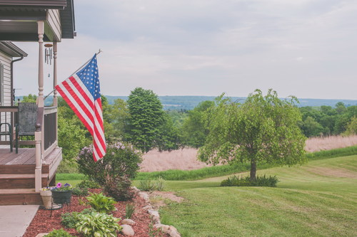 Hanging farmhouse in the American flag Stock Photo