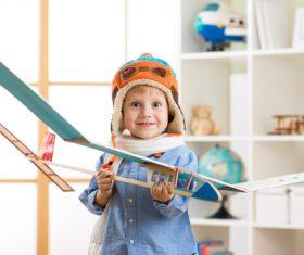 Happy child holding paper glider Stock Photo
