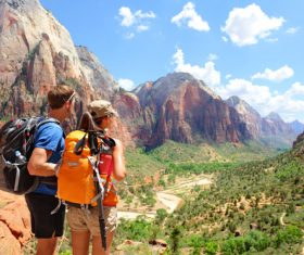 Hikers looking at view pointing hiking in mountain Stock Photo 02
