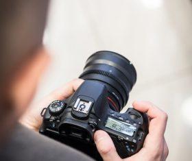 Holding digital camera Stock Photo 02