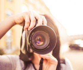 Holding the camera close range Stock Photo