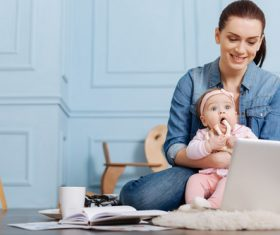 Housewife holding a child online Stock Photo 01