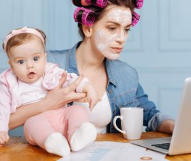 Housewife holding a child online Stock Photo 02