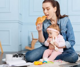 Housewife holding a child to eat Stock Photo