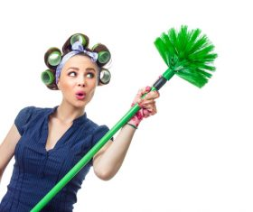 Housewife holding broom Stock Photo