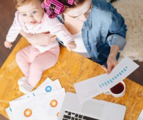 Housewife holding child looking at chart Stock Photo 04