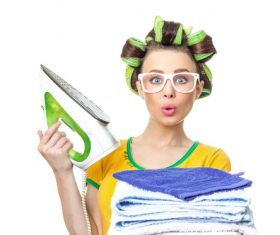 Housewife holding electric iron Stock Photo