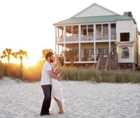 Hugging couple in front of the beach hotel Stock Photo