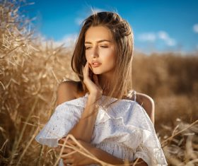 In the wheat field charming and attractive girl Stock Photo 02