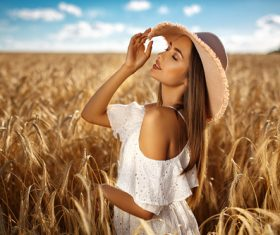 In the wheat field charming and attractive girl Stock Photo 03