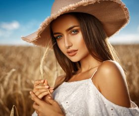 In the wheat field charming and attractive girl Stock Photo 04