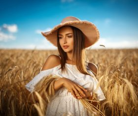 In the wheat field charming and attractive girl Stock Photo 05