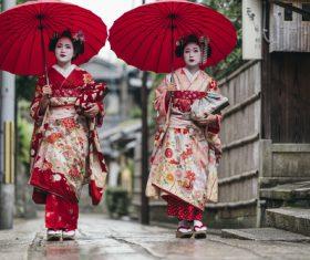 Japanese geisha walking down the street Stock Photo