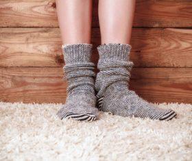Knit socks and carpet close-up Stock Photo