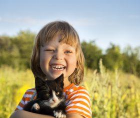 Little girl holding a kitten Stock Photo