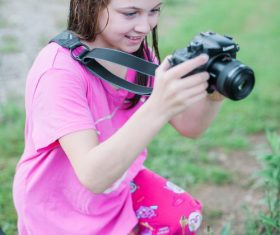 Little girl taking a photo with camera Stock Photo