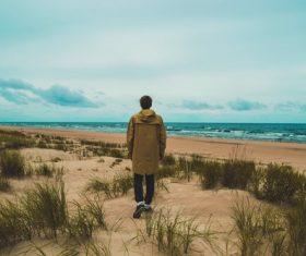 Lonely man walking on seaside Stock Photo