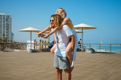 Man carrying his girlfriend Stock Photo