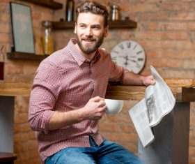 Man drinking coffee and reading newspaper Stock Photo 02