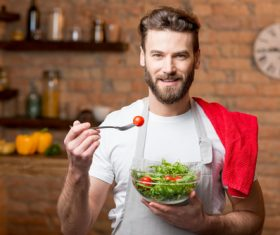 Man eating vegetable salad Stock Photo 02