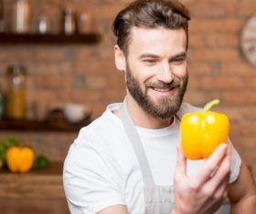 Man holding colorful pepper Stock Photo