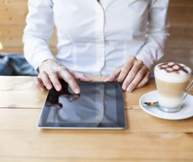 Man in cafe Uses tablets pc Stock Photo