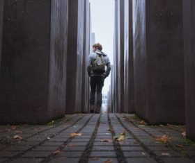 Man walking in an empty alley Stock Photo