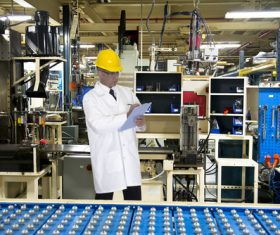 Man who made record before the factory production line Stock Photo