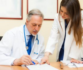 Medical professor and young female student Stock Photo 01