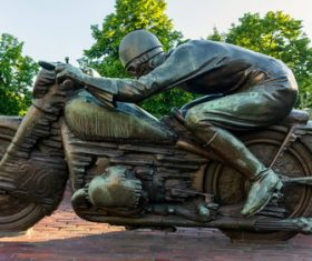 Motorcycle driver bronze statue Stock Photo