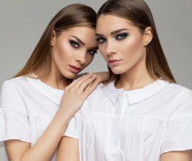 Painted black eyeshadows Beautiful fashion sisters Stock Photo 02