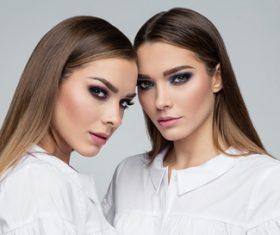 Painted black eyeshadows Beautiful fashion sisters Stock Photo 05